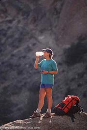Backpacker taking a drink; Size=180 pixels wide